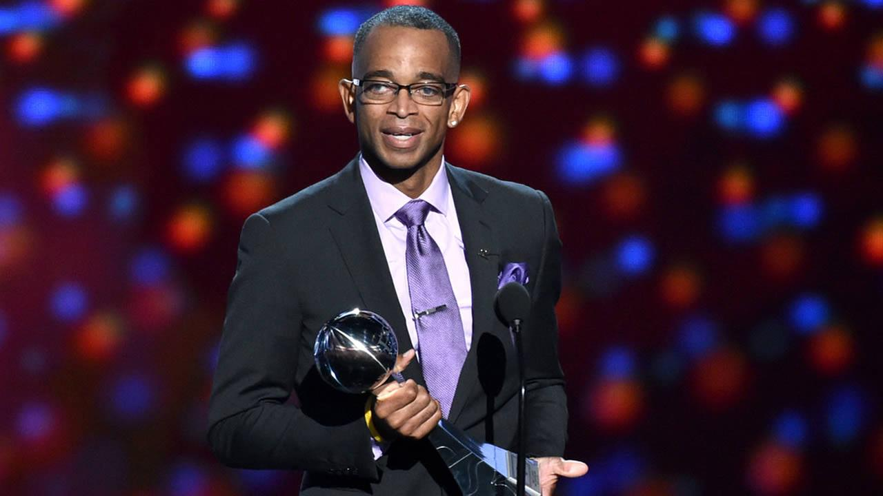 In a July 16, 2014 file photo, sportscaster Stuart Scott accepts the Jimmy V award for perseverance, at the ESPY Awards at the Nokia Theatre, in Los Angeles. (Photo by John Shearer/Invision/AP, File)