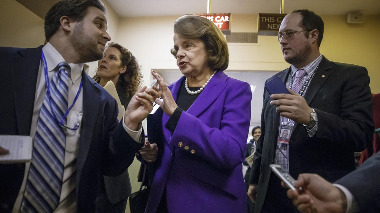 Senate Intelligence Committee Chair Sen. Dianne Feinstein, D-Calif. is pursued by reporters on Capitol Hill in Washington, Tuesday, Dec. 9, 2014.