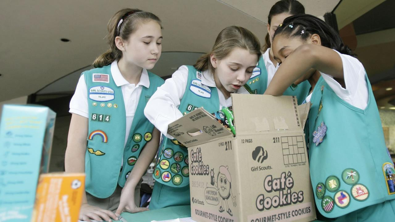 Girl Scouts sort through a case of Girl Scout cookies, Friday, Feb. 23, 2007, in Dallas. (AP Photo/Matt Slocum)