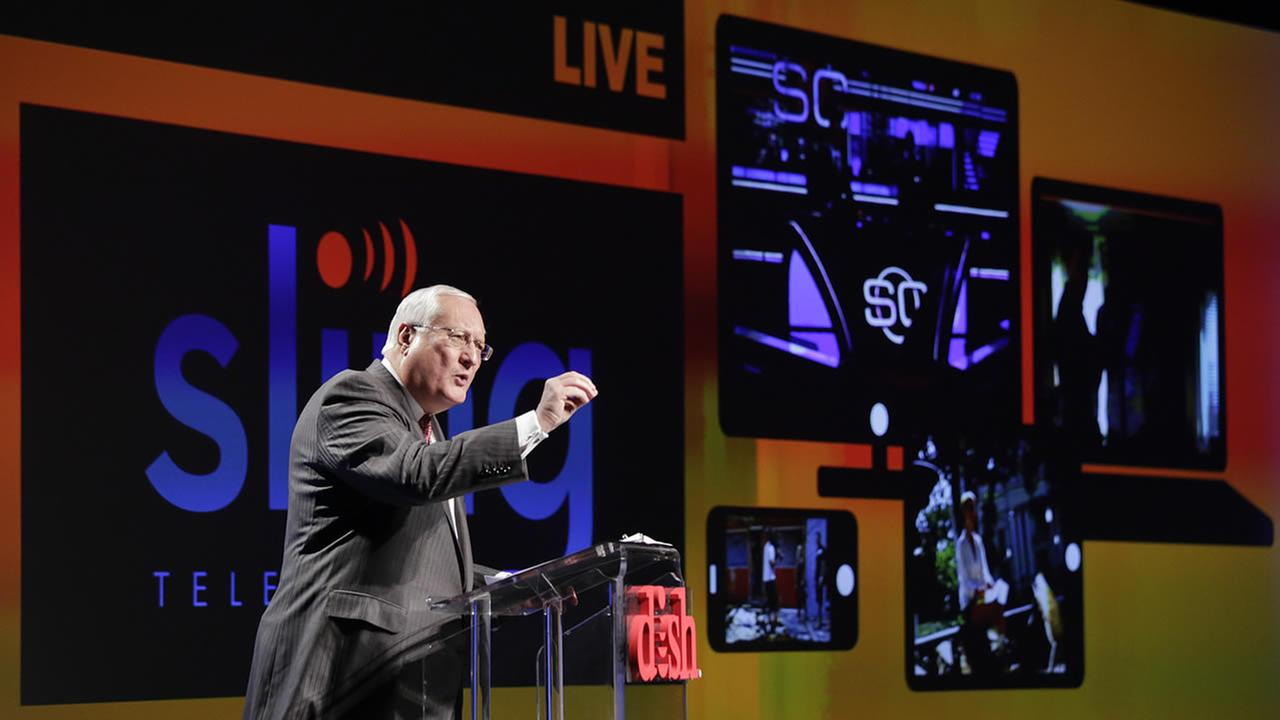 Joe Clayton, president and CEO of Dish Network, introduces the Sling TV at a news conference at the International CES, Monday, Jan. 5, 2015, in Las Vegas. (AP Photo/Jae C. Hong)