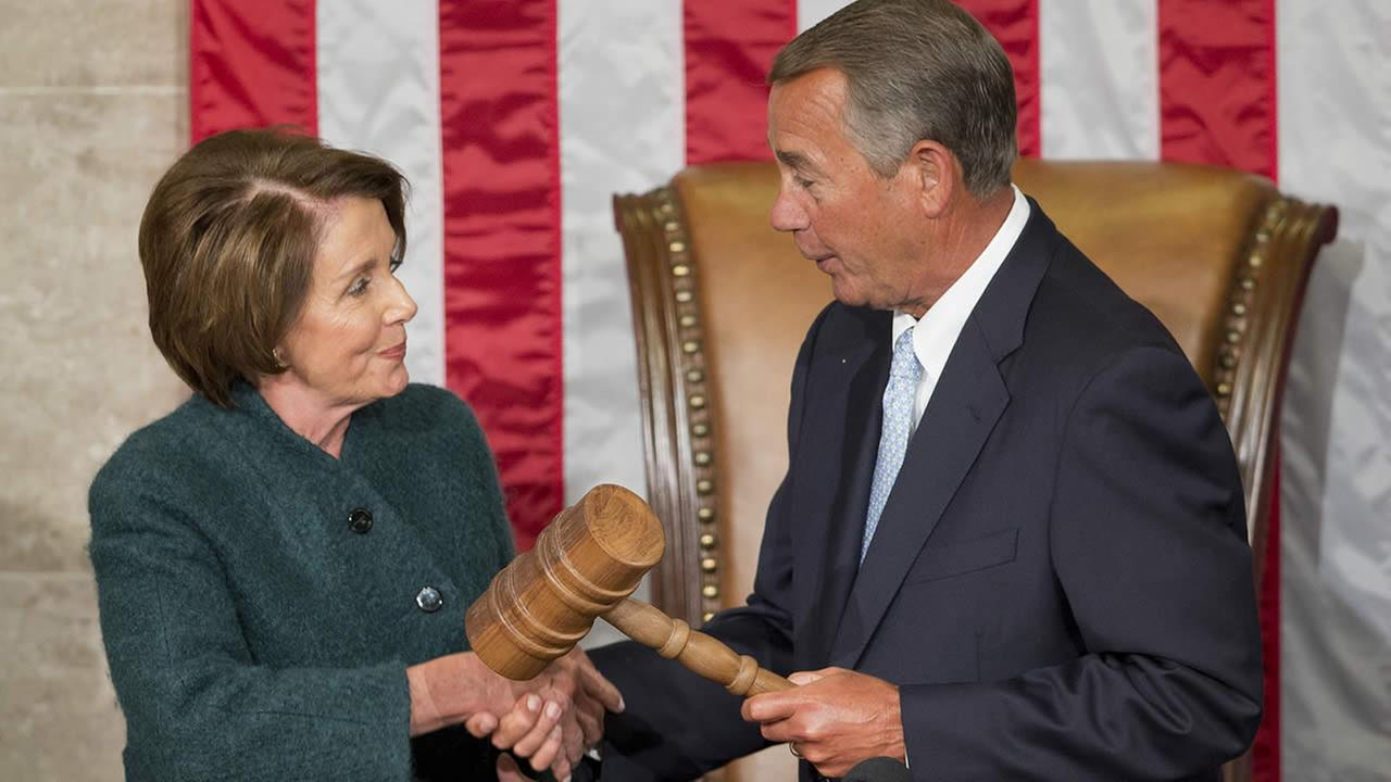 House Speaker John Boehner of Ohio, right, is handed the gavel from House Minority Leader Nancy Pelosi, D-Calif, left, at the Capitol in Washington, Jan. 6, 2015. (AP Photo/Pablo Martinez Monsivais)