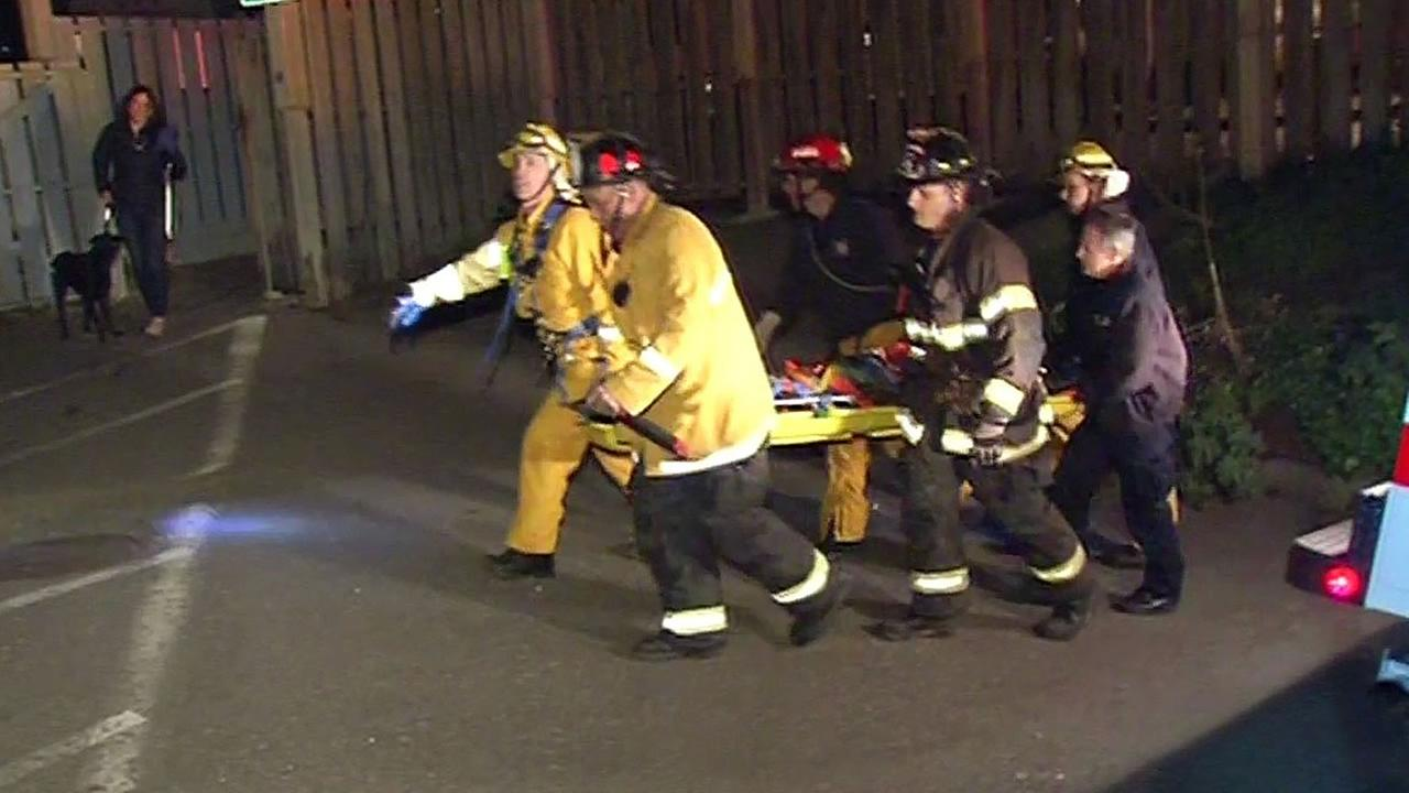 Daly City firefighters lift up a man who fell down a cliff