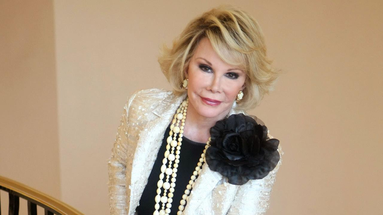 This Oct. 5, 2009, file photo shows Joan Rivers posing as she presents Comedy Roast with Joan Rivers  during the 25th MIPCOM in Cannes, France.