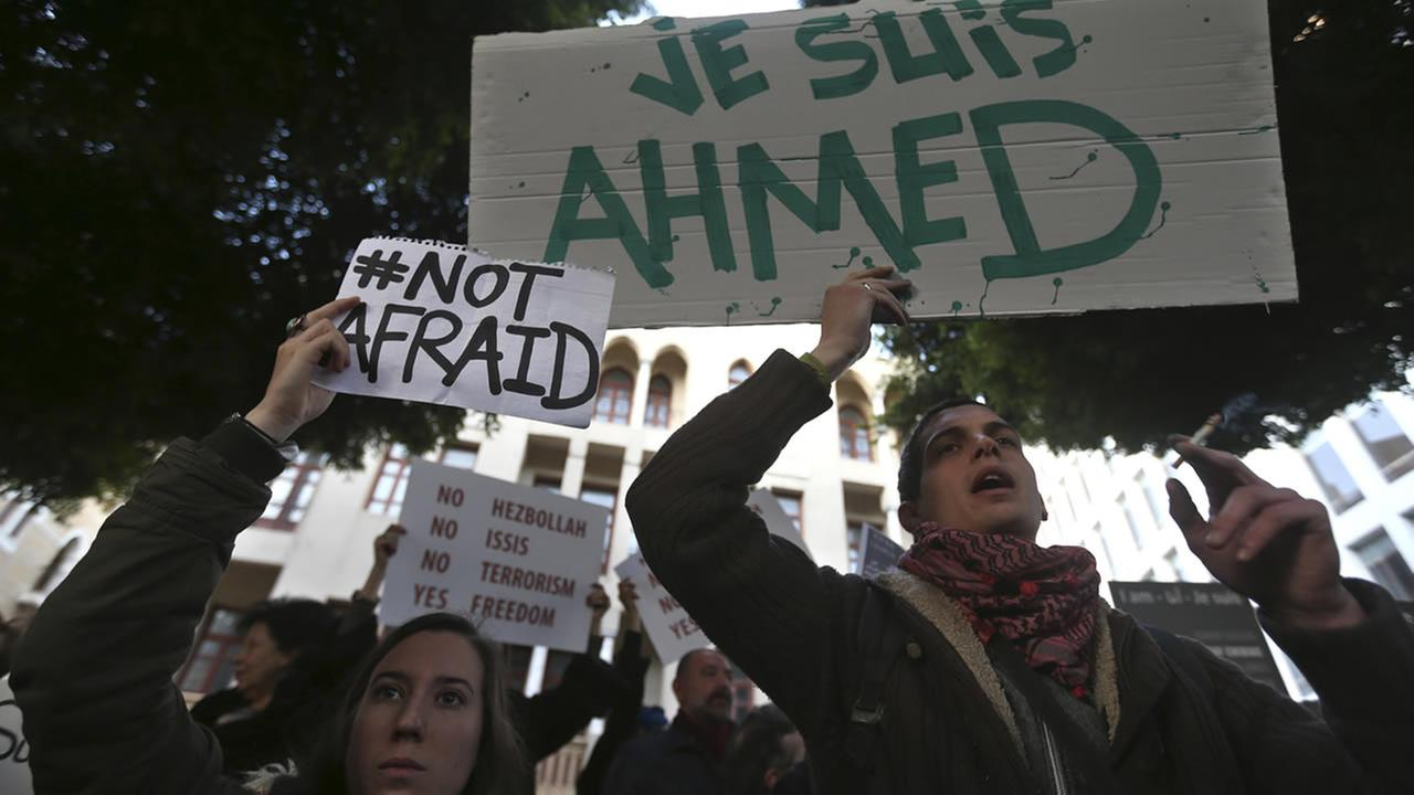 A French placard reads, I am Ahmed, for Ahmed Merabet, a Muslim policeman killed by gunmen during a terrorist attack in Paris. (AP Photo/Hussein Malla)