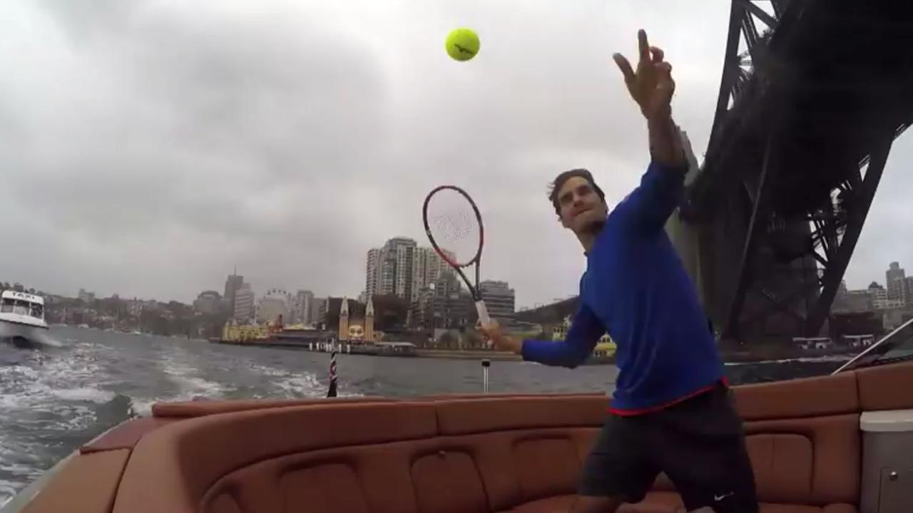 Roger Federer and Lleyton Hewitt played speed boat tennis in Australias Sydney Harbour, Jan. 12, 2015.