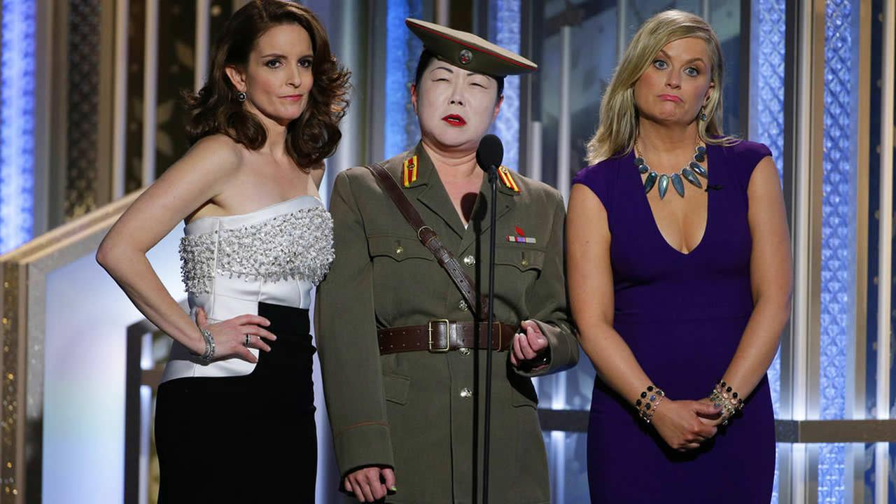 Tiny Fey, Margaret Cho and Amy Poehler speak at the 72nd Annual Golden Globe Awards on Jan. 11, 2015, at the Beverly Hilton Hotel in Beverly Hills, Calif. (AP Photo/NBC, Paul Drinkwater)