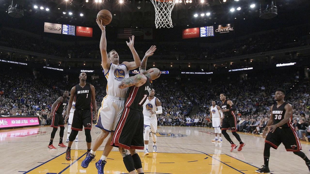 Golden State Warriors forward David Lee (10) shoots against Miami Heat forward Chris Andersen during the first half of an NBA basketball game in Oakland, Calif., Wednesday.