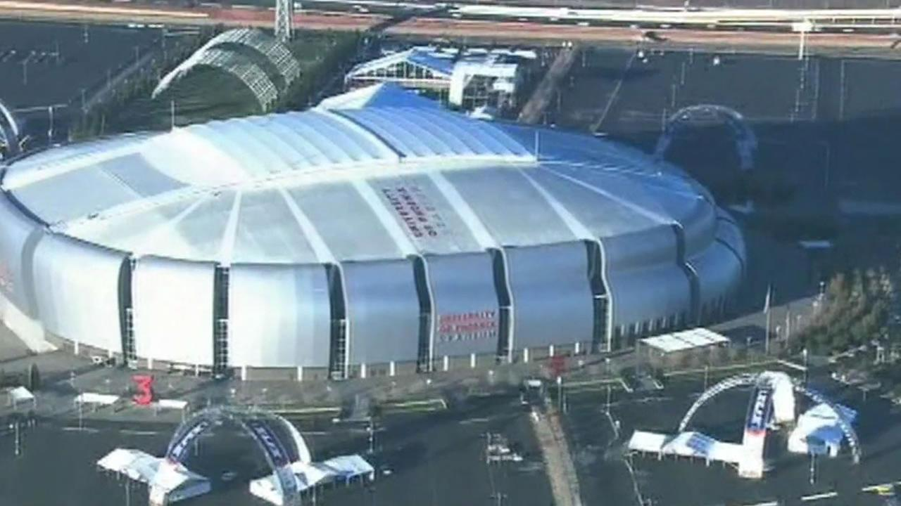 A construction worker died after falling from a stage being built outside the University of Phoenix Super Bowl Stadium.