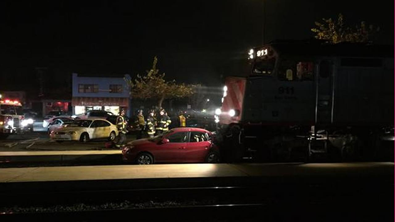 Caltrain is delayed southbound after a train hit the back of a car that was on the tracks in Burlingame at the Broadway crossing.