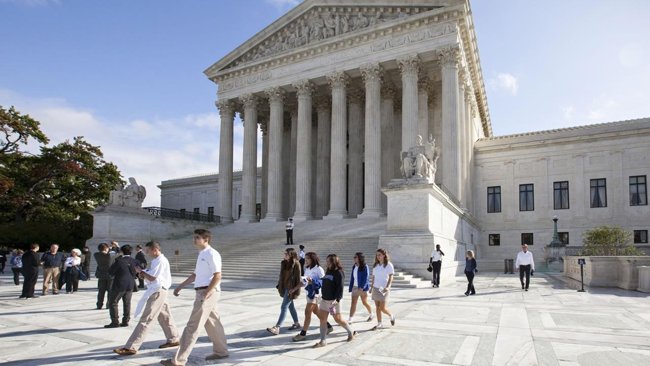 Visitors line up to enter the Supreme Court in Washington, Tuesday, Oct. 14, 2014, as it begins the second week of its new term.