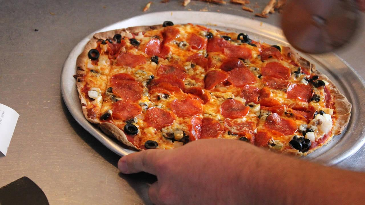 This Oct. 10, 2014 photo provided by the Springfield, Missouri, Convention and Visitors Bureau shows a St. Louis-style pizza.  (AP Photo)