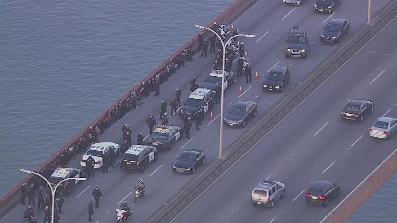 Protesters unfolded a Palestinian flag and blocked traffic on the San Mateo Bridge on Monday, Jan. 19, 2015.