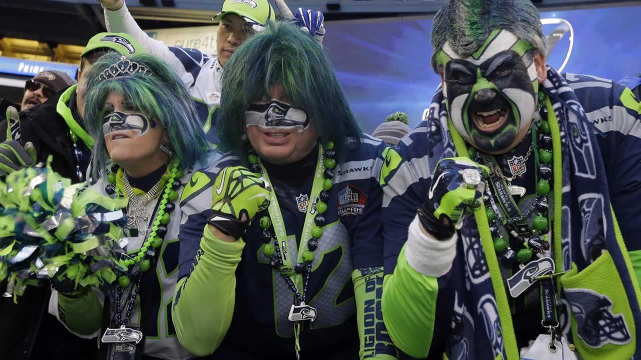 Seattle Seahawks fans celebrate after overtime of the NFL football NFC Championship game against the Green Bay Packers Jan. 18, 2015, in Seattle. (AP Photo/Ted S. Warren)