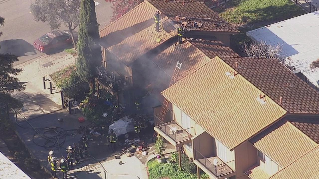 Firefighters battle fire at residence in Hayward fire.