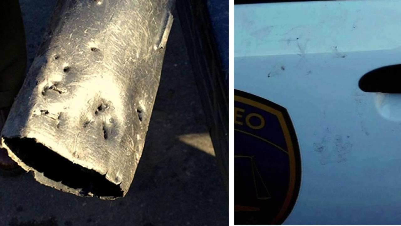 Police snapped a picture of bite marks left by two pit bulls in a leaf blower that a landscaper used to defend himself when they attacked.