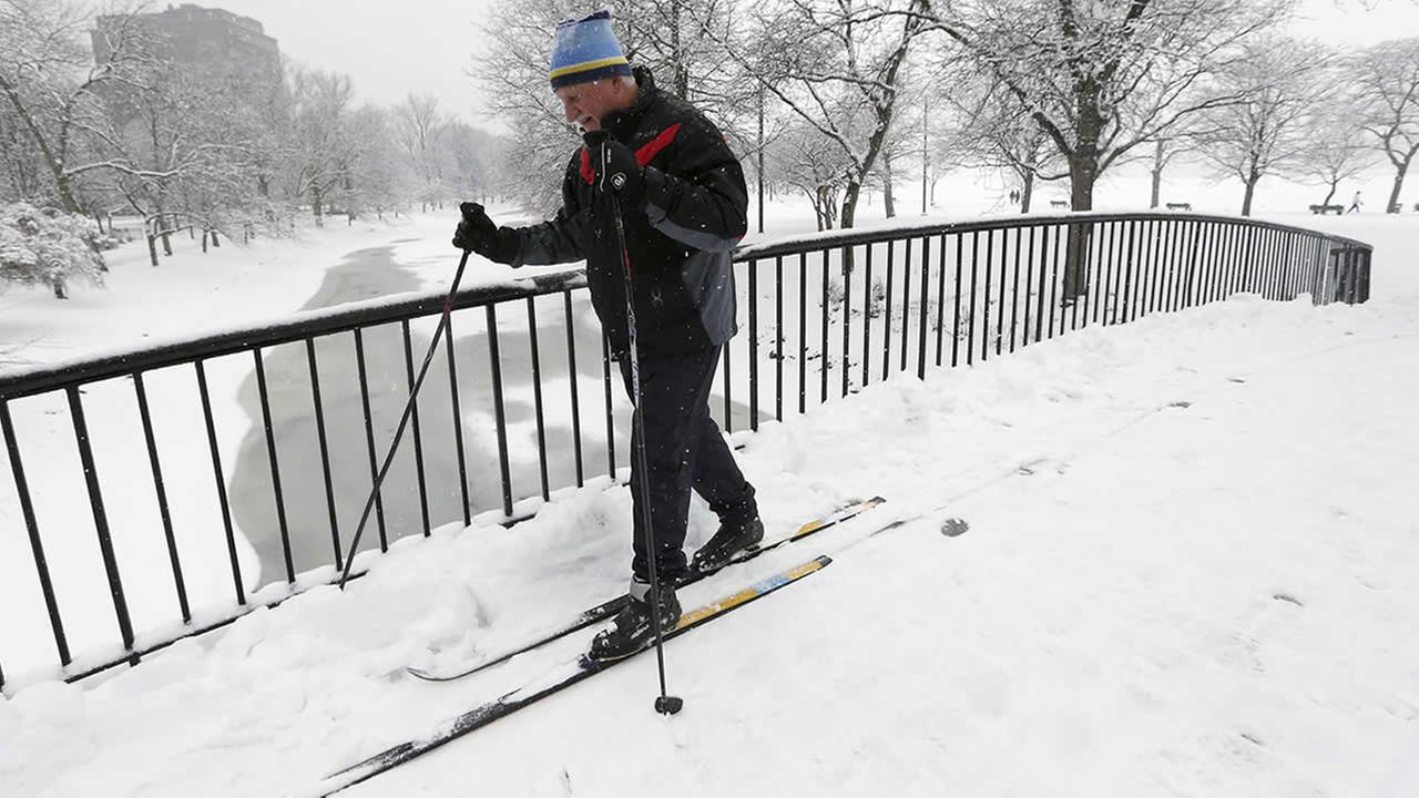 Irv Rosenberg, of Boston, uses cross country skis on the Esplanade in Boston, Saturday, Jan. 24, 2015. (AP Photo/Michael Dwyer)