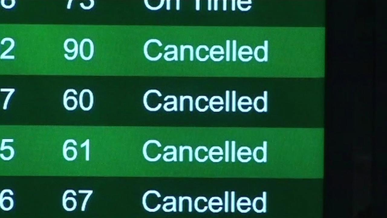 Sign shows flights cancelled at San Francisco International Airport on Jan. 26, 2015.