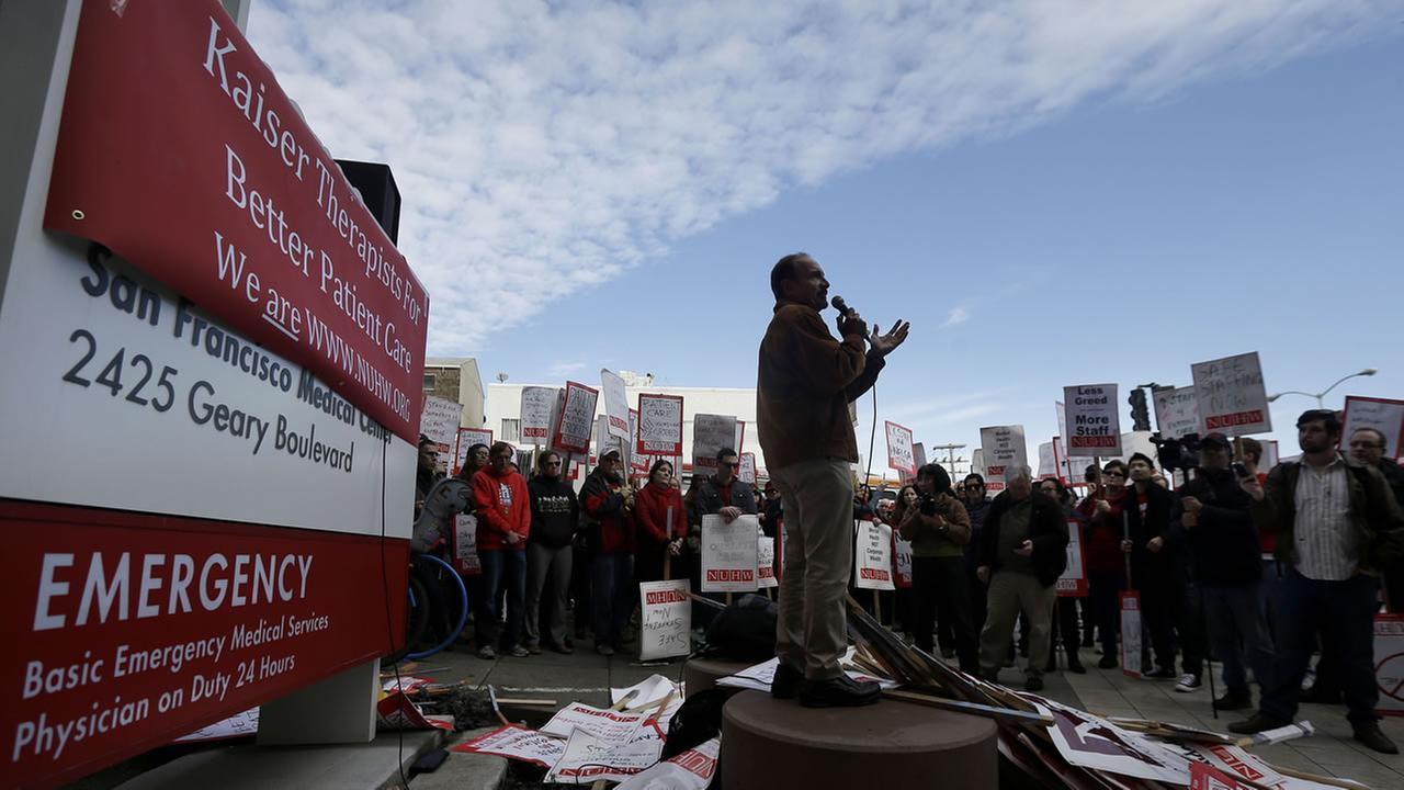 Sal Rosselli, president of the National Union of Healthcare Workers, speaks at a rally outside of a Kaiser Permanente facility in San Francisco, Monday, Jan. 12, 2015.