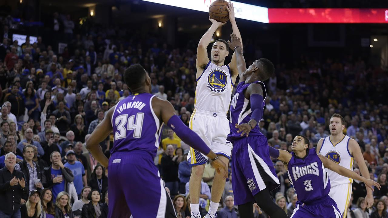Golden State Warriors Klay Thompson (11) shoots over Sacramento Kings Jason Thompson (34) and Ray McCallum (3) during the third quarter of an NBA basketball game Friday, Jan. 23.