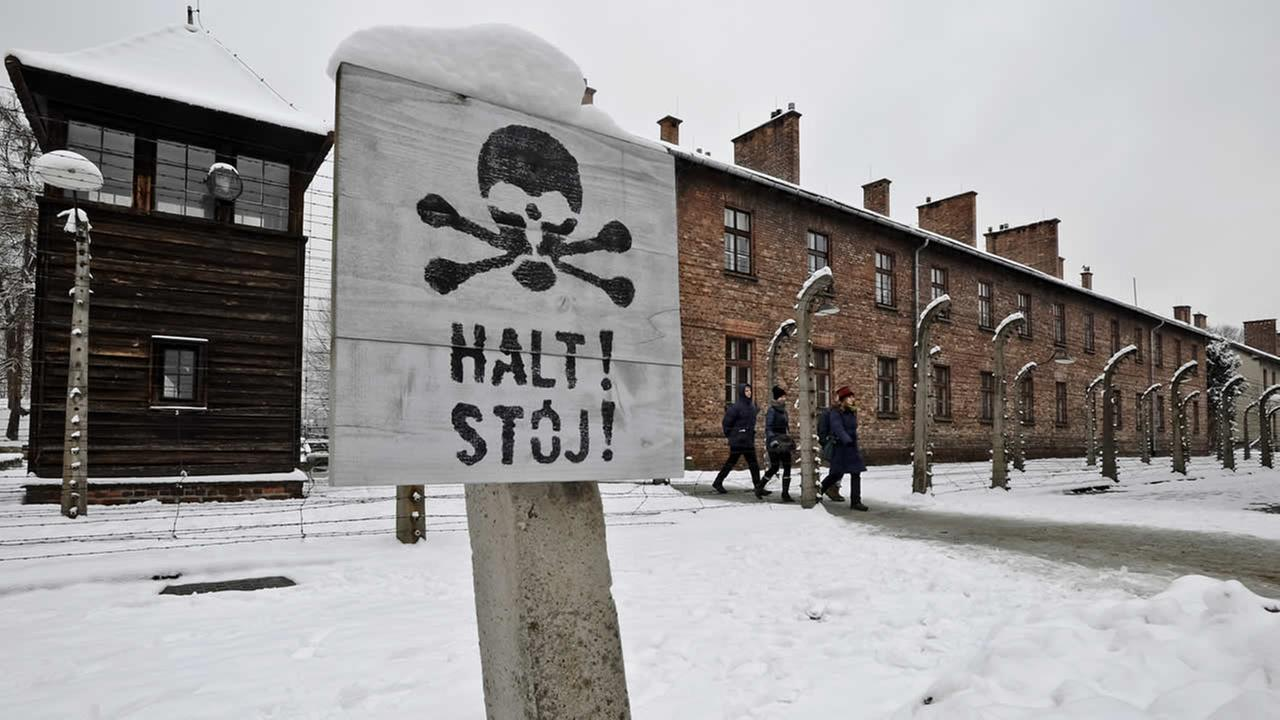 Visitors walk at the Auschwitz Nazi death camp in Oswiecim, Poland, Monday, Jan. 26, 2015. (AP Photo/Alik Keplicz)