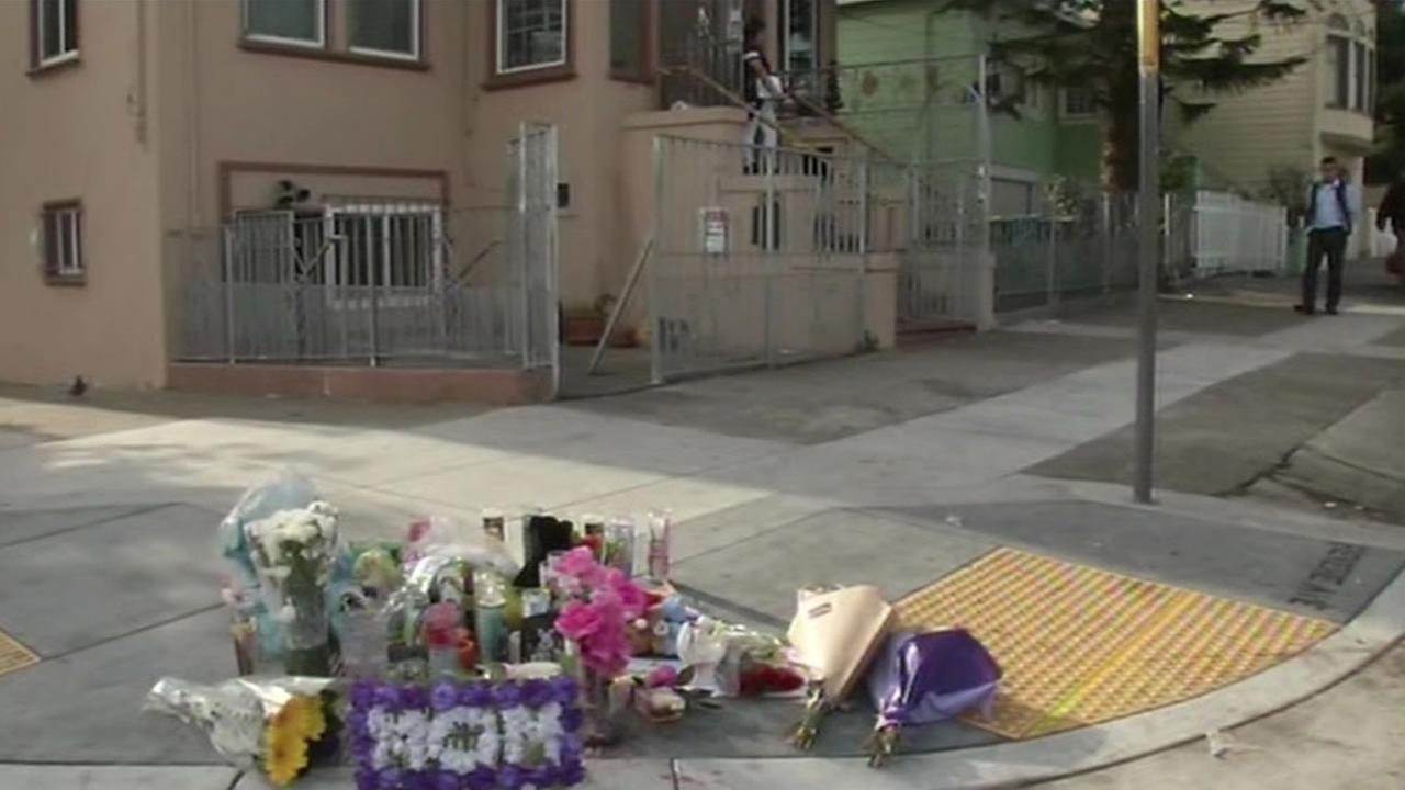 A memorial keeps growing for a mother of three killed in the crossfire of a suspected gang shooting in San Franciscos Bayview District.