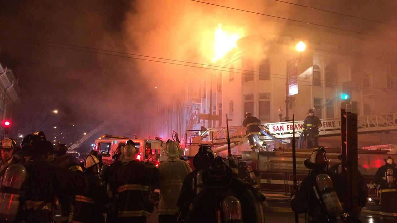 A fire burns in the Mission District neighborhood of San Francisco, Calif. on Jan. 28, 2015.