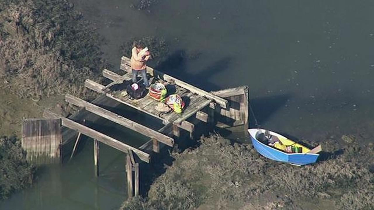 A woman and her dog have been found safe after a search for them in low tide near Redwood City.