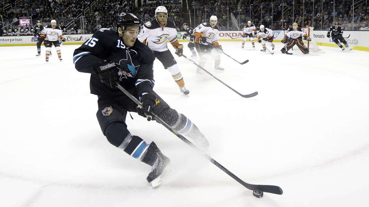 San Jose Sharks James Sheppard (15) controls the puck against the boards in front of Anaheim Ducks Devante Smith-Pelly