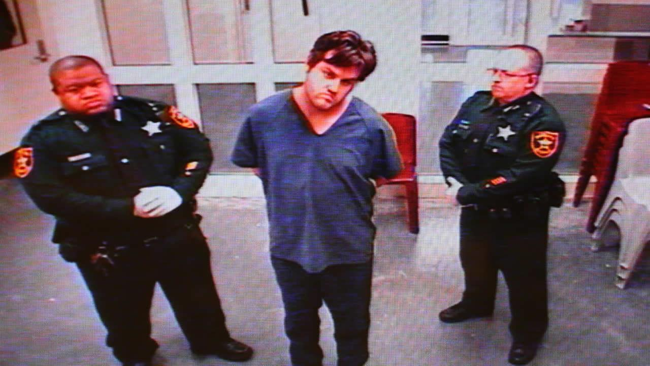 Murder suspect John Jonchuck Jr., center, appears via video as he is appointed an attorney during his first preliminary hearing on Jan. 12, 2015 in Clearwater, Fla. (AP Photo/Tampa Bay Times, Douglas R. Clifford, Pool)