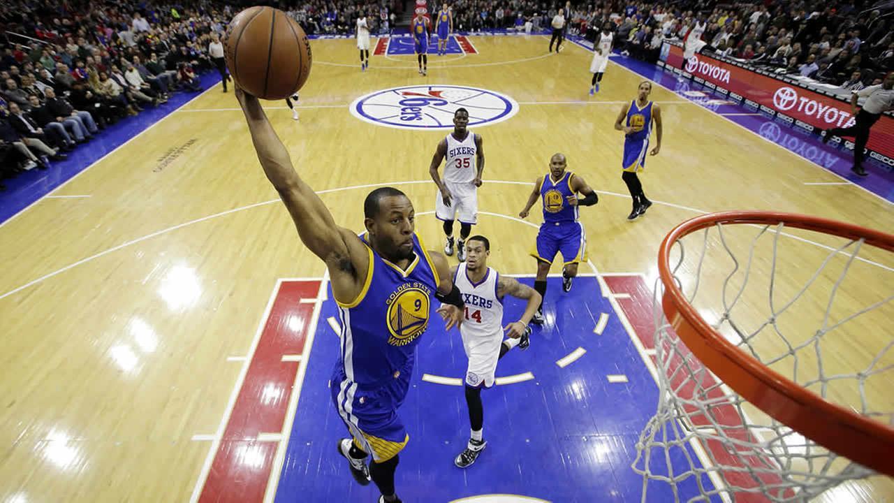 Golden State Warriors Andre Iguodala dunks during the first half of a game against the Philadelphia 76ers, Feb. 9, 2015, in Philadelphia. (AP Photo/Matt Slocum)