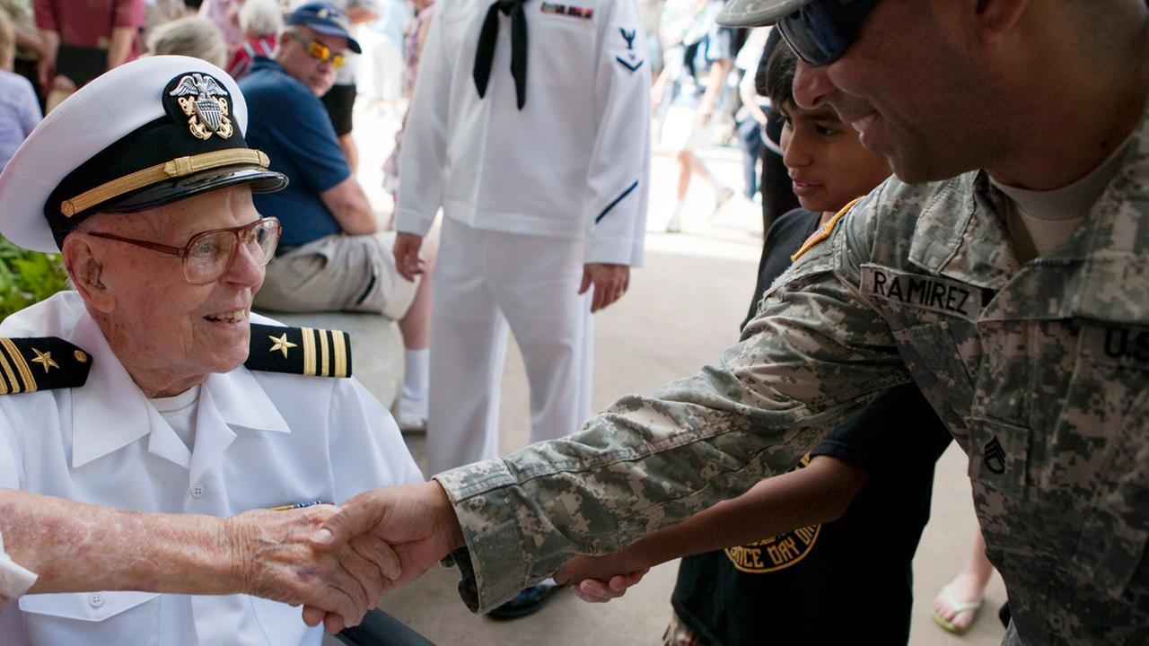 USS Arizona survivor Joseph Langdell, left, greets Sgt. Carlos Ramirez at the Pearl Harbor Memorial, Wednesday, Dec. 7, 2011, in Pearl Harbor, Hawaii.