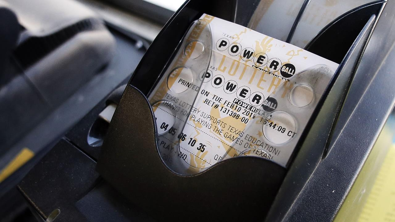 A Powerball ticket sits in the tray dispenser after being printed out for a customer at Fuel City Tuesday, Feb. 10, 2015, in Dallas.  (AP Photo/Tony Gutierrez)