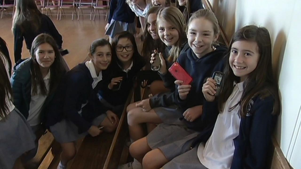 Sacred Heart students show off their smartphones in San Francisco on Feb. 12, 2015.