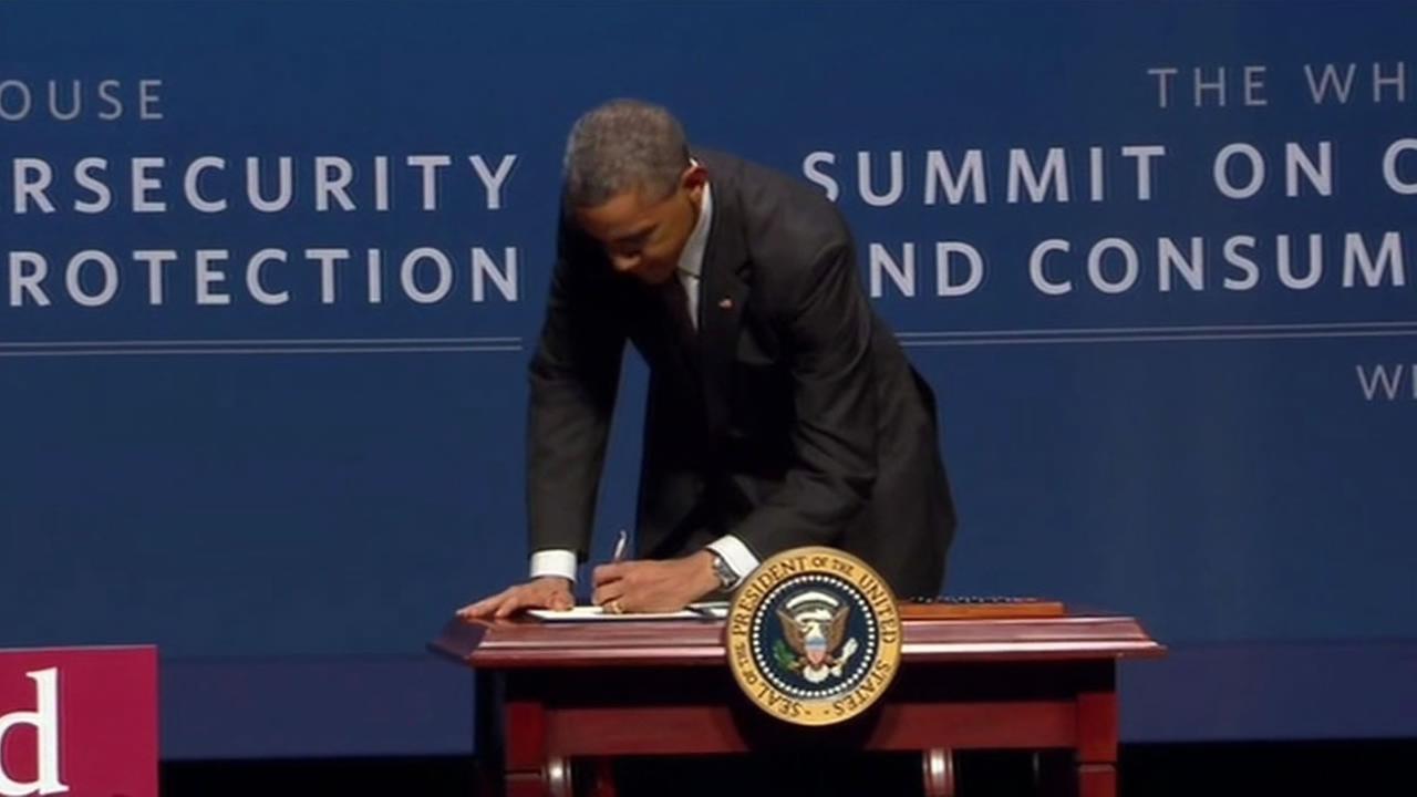 Obama signing an order