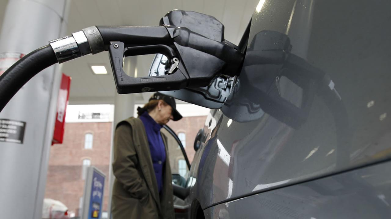 Deborah Delauro waits as she puts gas in her car Friday, Feb. 24, 2012 in Philadelphia. (AP Photo/Alex Brandon)