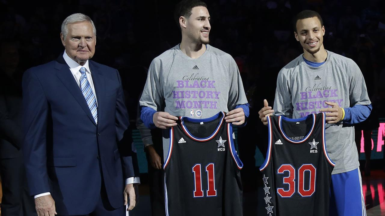 Golden State Warriors executive Jerry West, left, presents All-Star jerseys to guards Klay Thompson (11) and Stephen Curry (30) on Feb. 4, 2015 in Oakland.AP Photo/Marcio Jose Sanchez