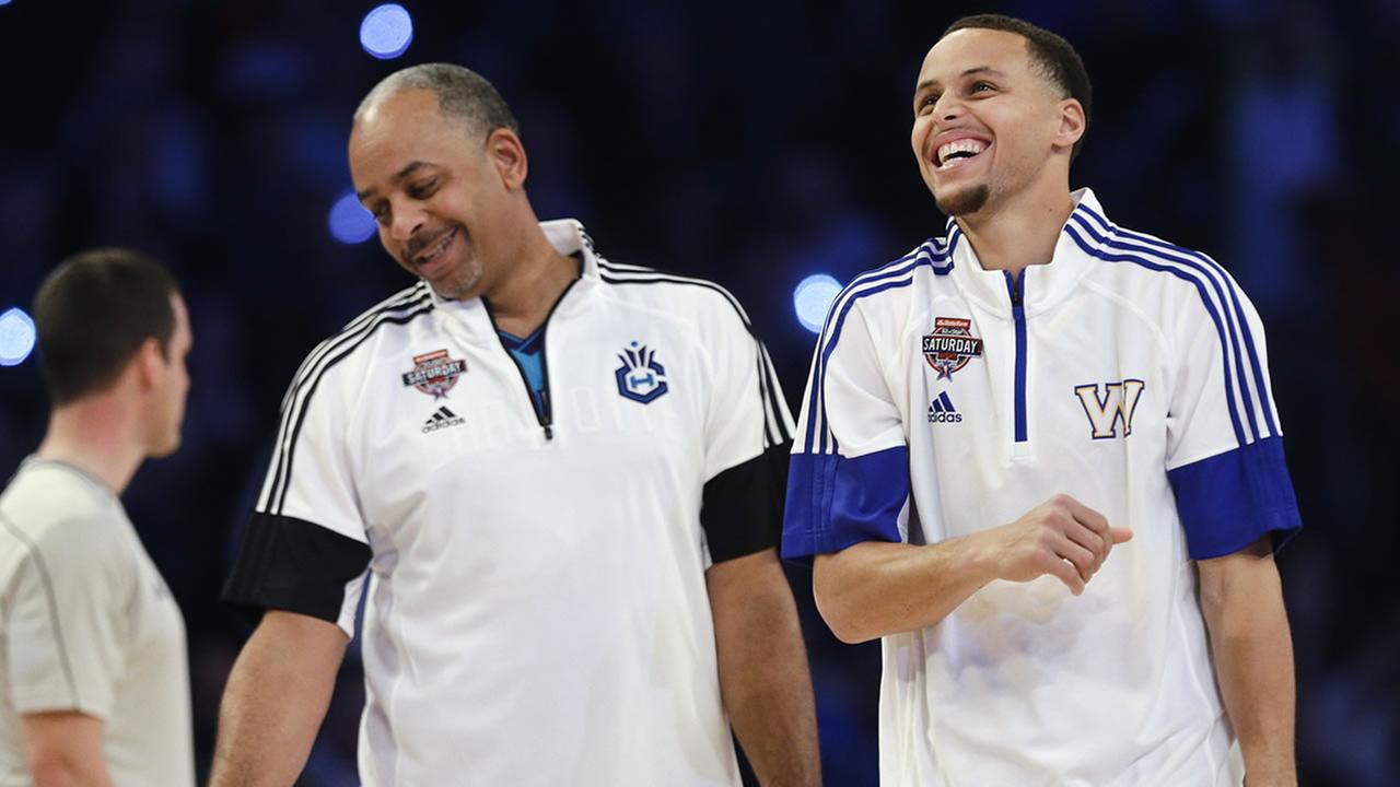 Warriors Stephen Curry celebrates with his father, Dell Curry, left, during the NBA All-Star Saturday Shooting Stars event Saturday, Feb. 14, 2015, in New York. (AP Photo)