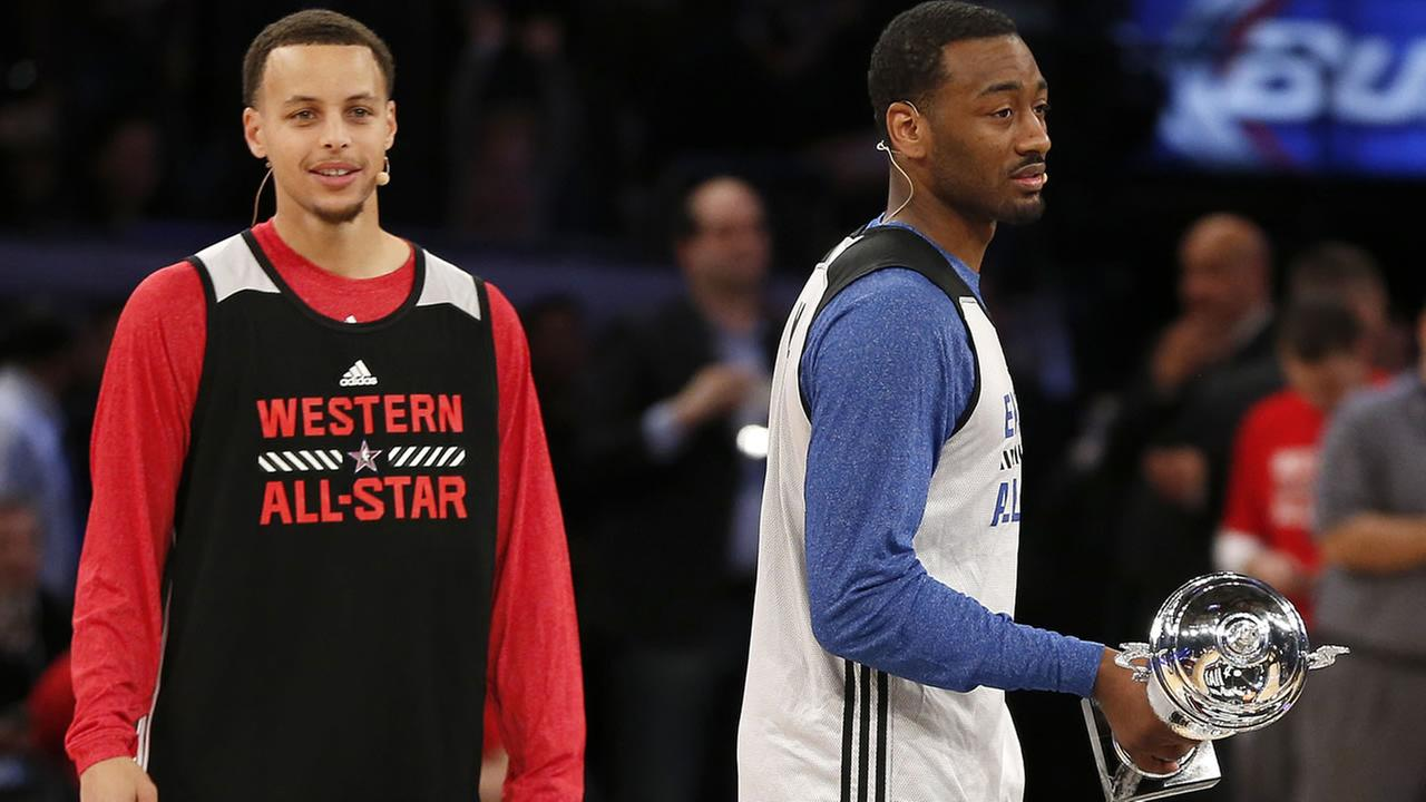 West Teams Stephen Curry, left, of the Golden State Warriors, stands next to East Teams John Wall, of the Washington Wizards on Feb. 14, 2015, in New York. (AP Photo)