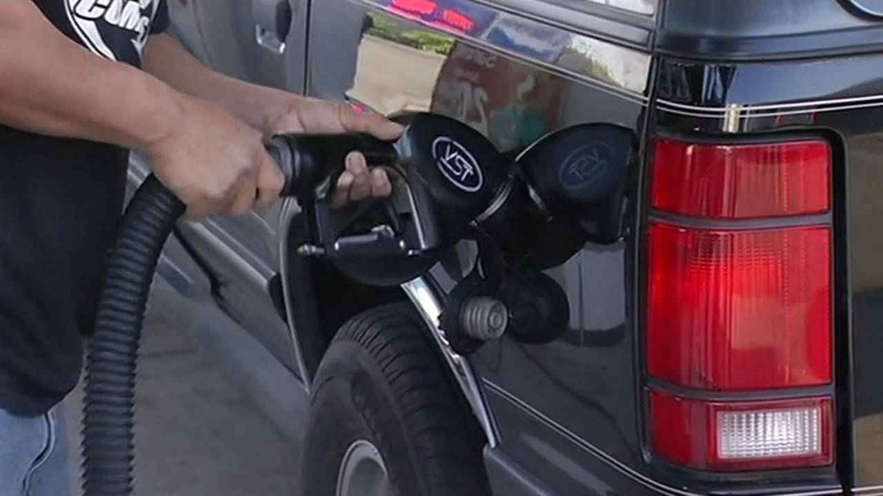 A man fills up his trucks tank at a gas station in San Jose, Calif. on Feb. 18, 2015.