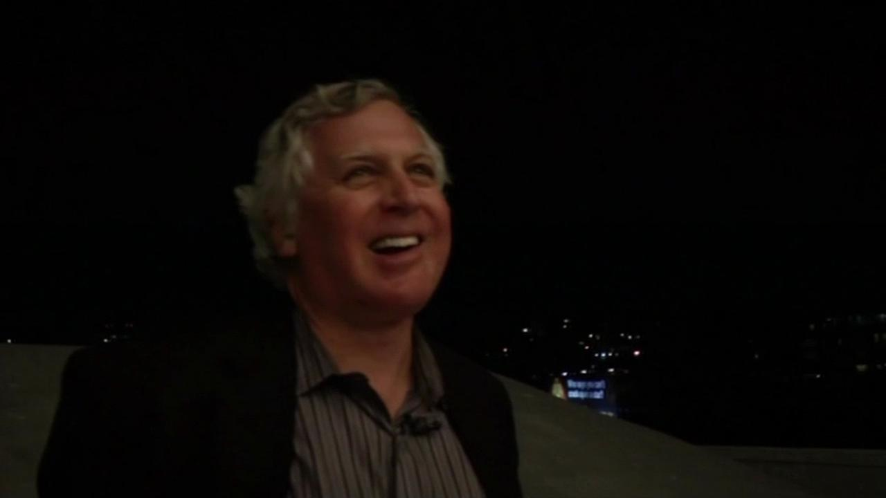 Grand Lake Theatre owner Allen Michaan smiles while watching the marquee light up the night sky in Oakland, Calif., Feb.2015.(ABC7/Wayne Freedman)