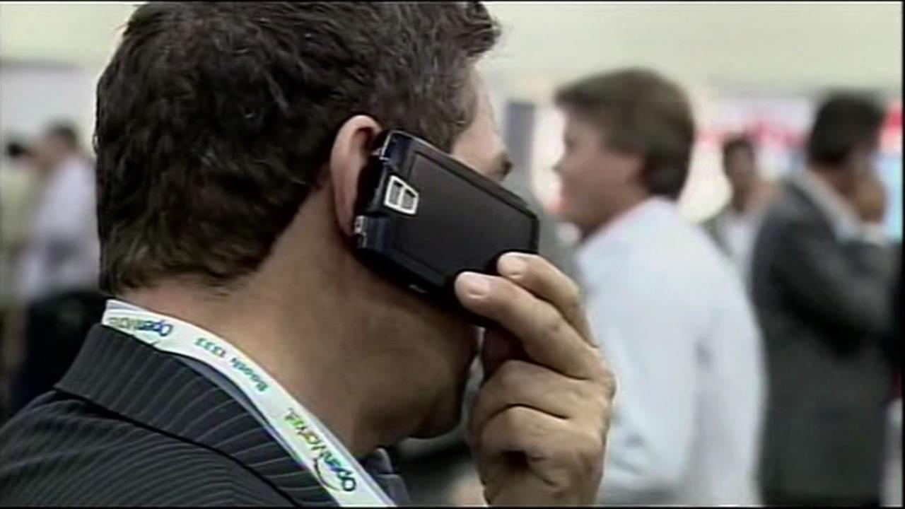 Man talks on a cellphone.