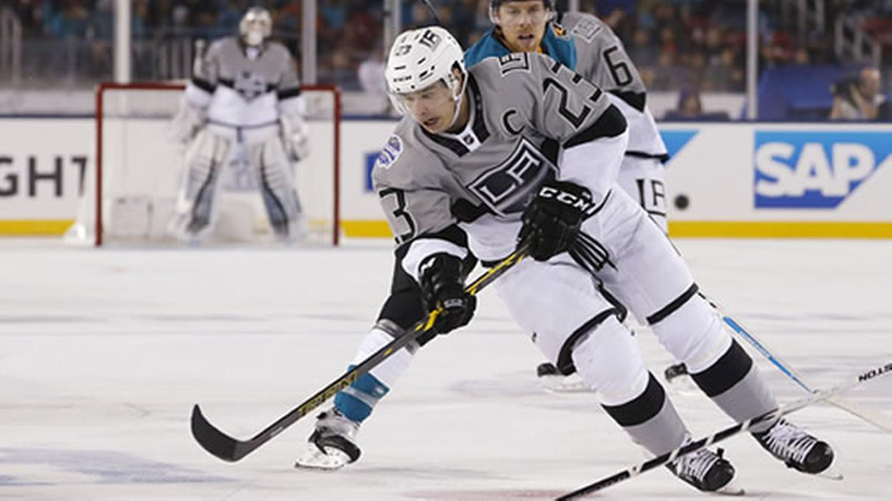 Los Angeles Kings Dustin Brown (23) is chased by San Jose Sharks Joe Pavelski during the second period of an NHL hockey game Saturday, Feb. 21, 2015.