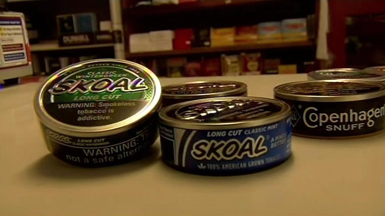 Cans of Skoal and Copenhagen chewing tobacco.