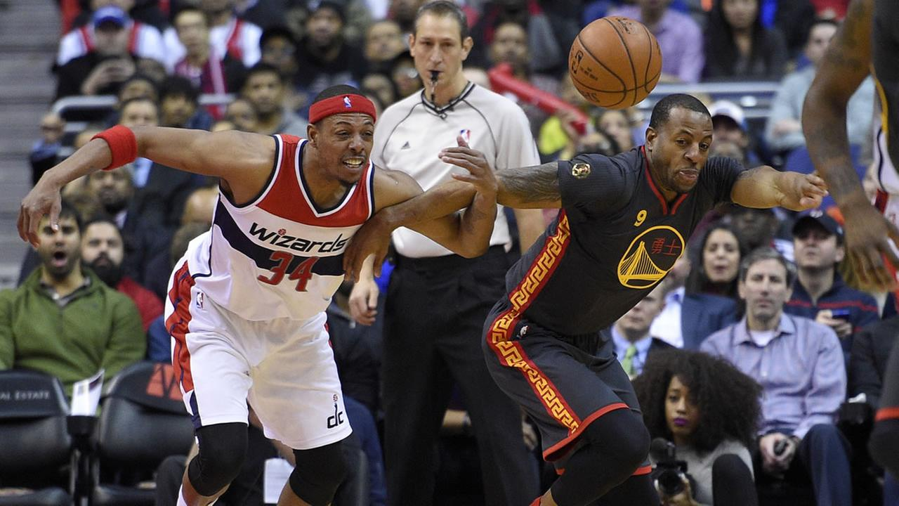 Washington Wizards forward Paul Pierce (34) battles for the ball against Golden State Warriors guard Andre Iguodala