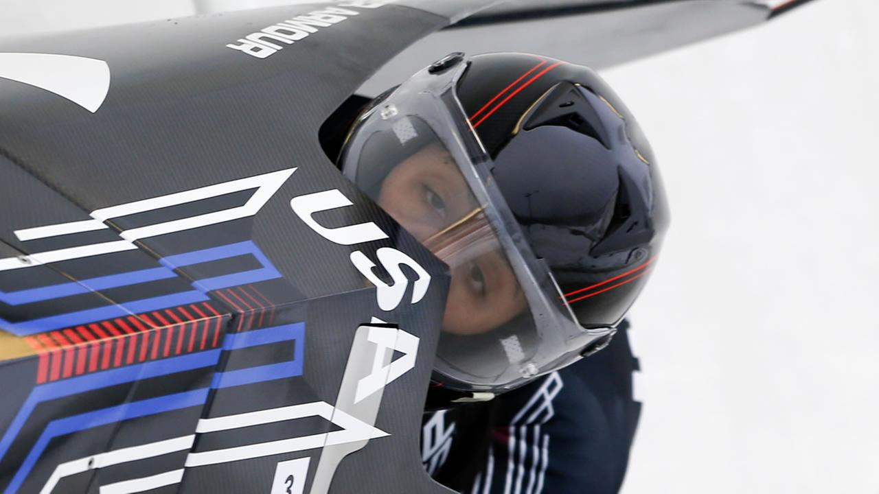 United States pilot Elana Meyers Taylor and brakeman Cherrelle Garrett compete in the womens bobsled World Cup on Saturday, Dec. 13, 2014, in Lake Placid, N.Y.