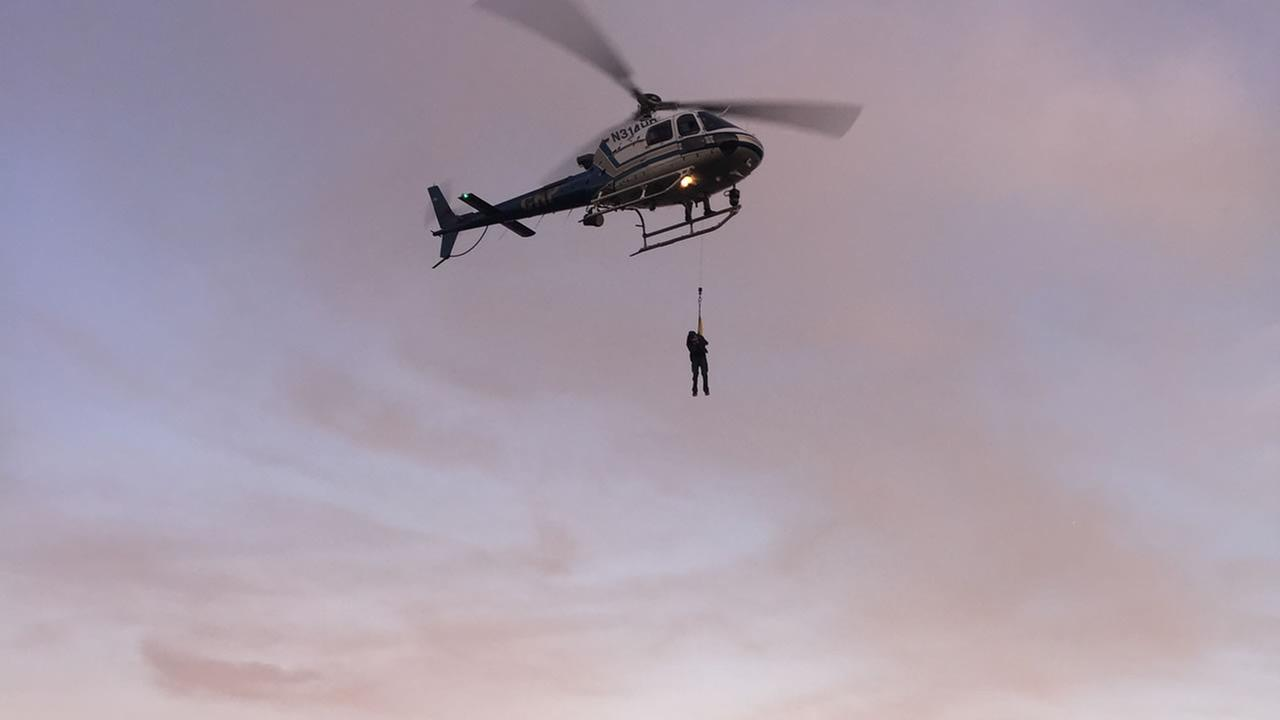 A California Highway Patrol helicopter lifts a suspect to safety during the rescue of two suspected vandals at Golden Gate National Recreation Area Thursday Feb. 26, 2015.