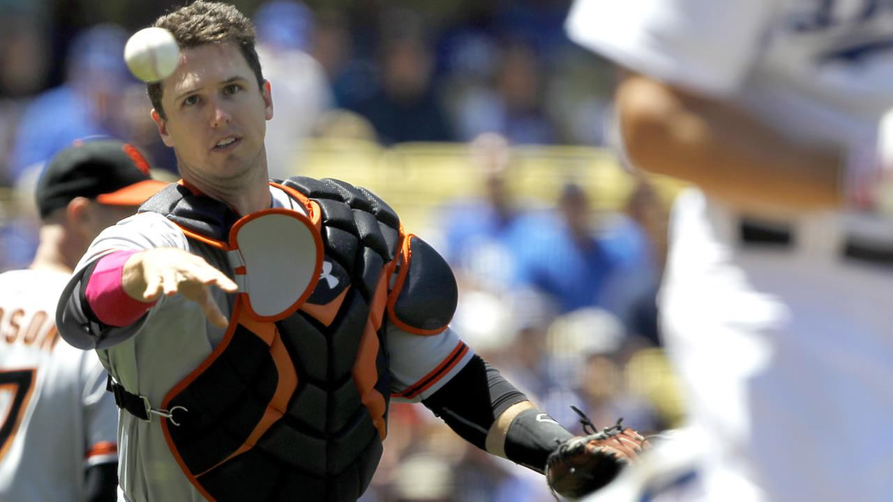 SF Giants catcher Buster Posey throws out Los Angeles Dodgers Clayton Kershaw in the third inning of a baseball game on Sunday, May 11, 2014, in LA. (AP Photo/Alex Gallardo)