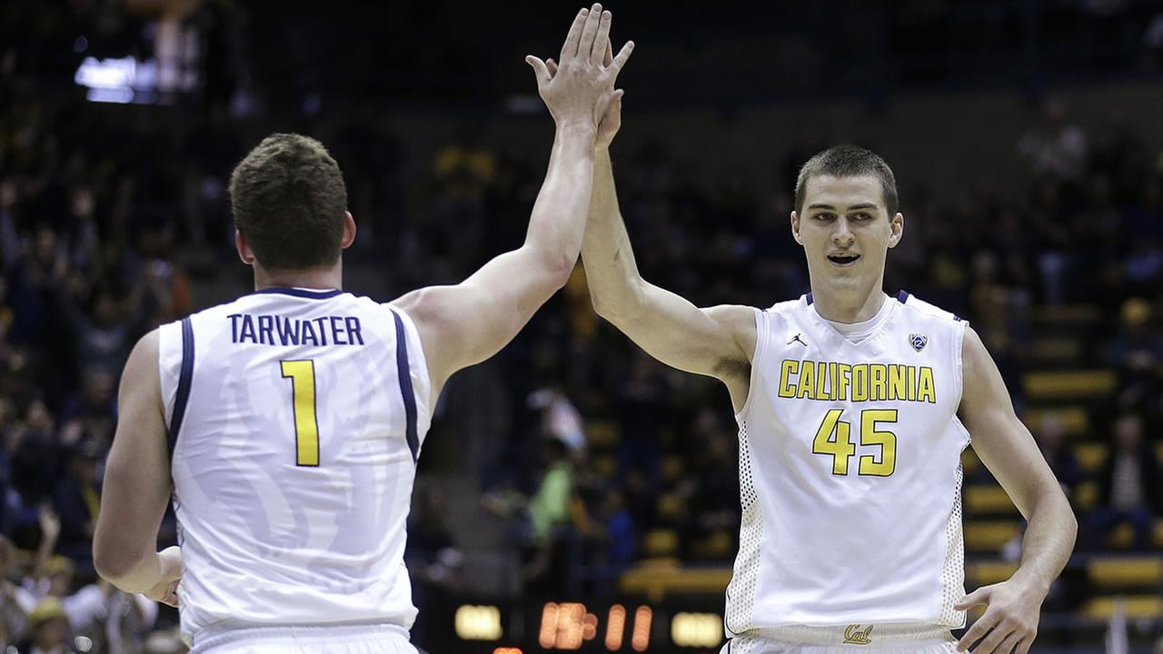 Cals David Kravish, right, and Dwight Tarwater celebrate a score against Oregon St. in the first half of an NCAA college basketball game Sunday, March 1, 2015, in Berkeley, Calif.
