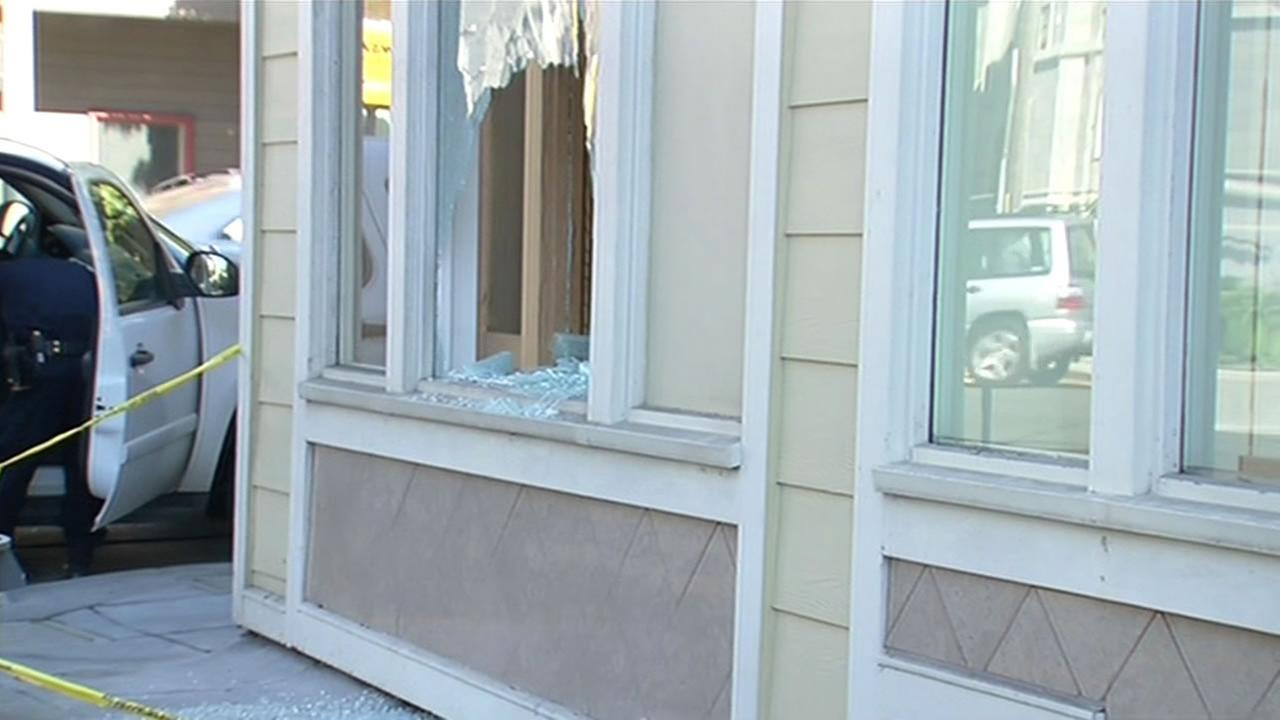 Police investigate a smash-and-grab burglary at Music Lovers in San Francisco on March 4, 2015.