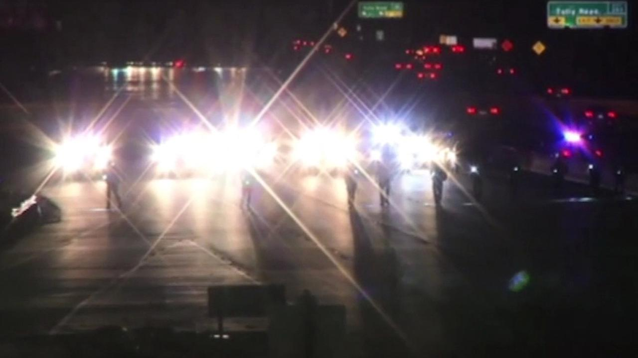 CHP shuts down Highway 101 in San Jose after a squad car was struck by a bullet.